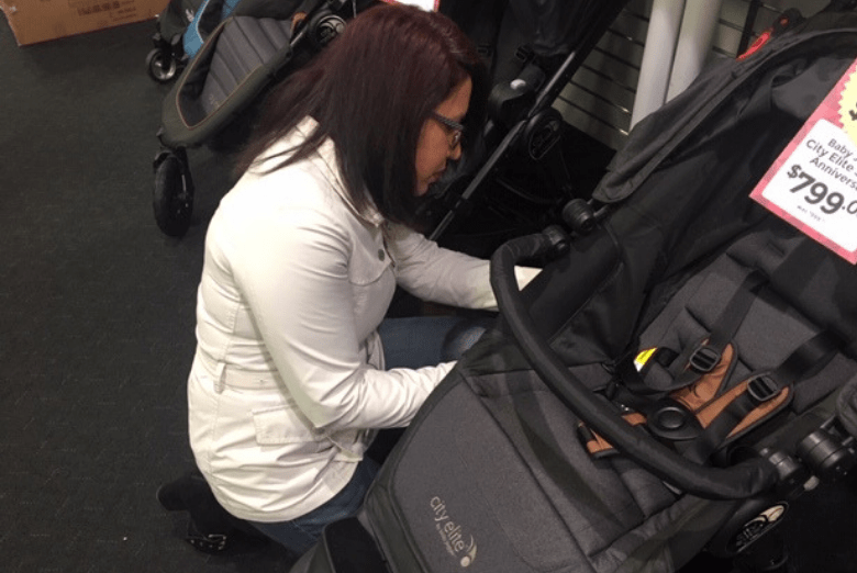 Woman Checking Strollers Carefully