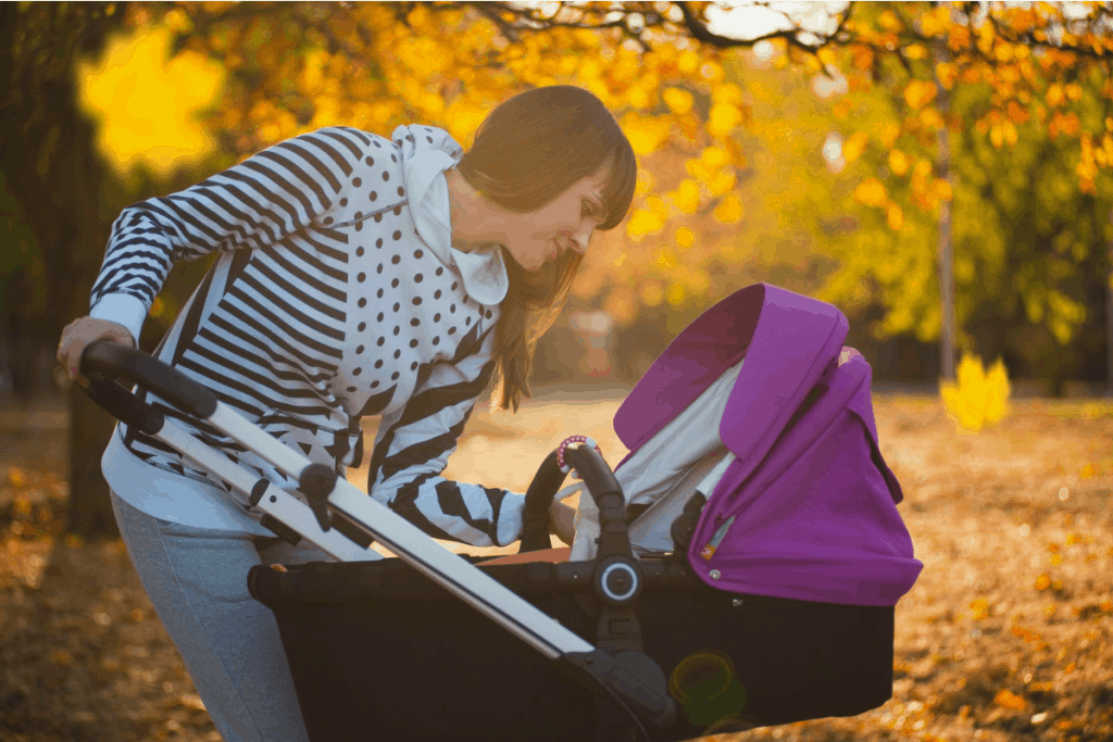 woman looking at her baby in stroller