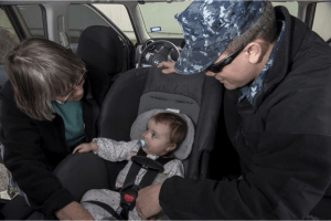 Parents Looking at Baby in Car Seat