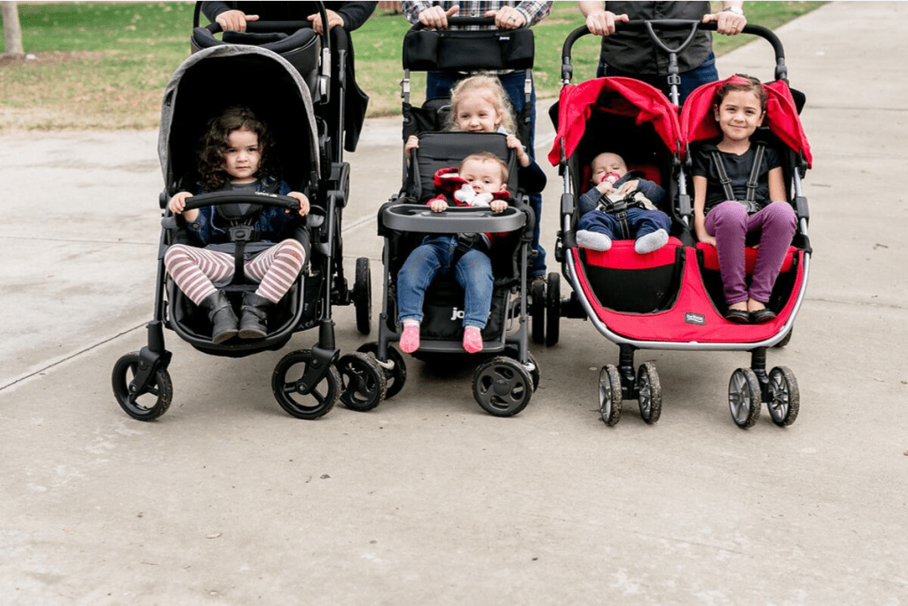 Children sitting in double strollers