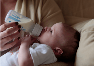 baby drinling with baby bottle