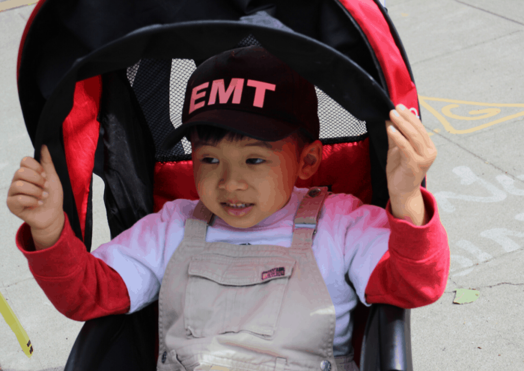 Boy sitting in a stroller
