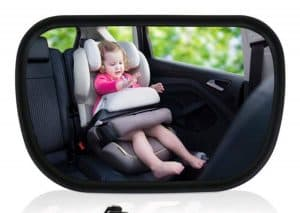 baby in a rearview car mirror