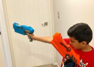 kid playing with nerf pistols