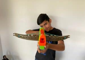 Boy holding a crossbow nerf