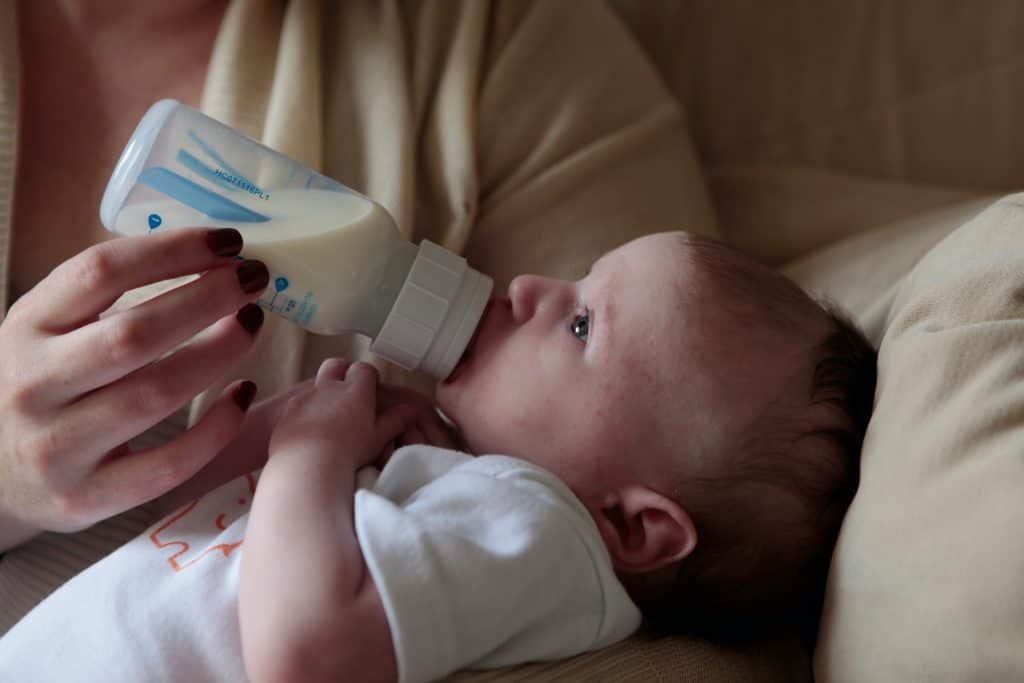 baby drinking with a baby bottle