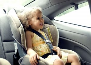 young girl sitting in a car seat