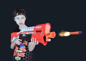 Boy playing with a Fortnite Nerf Gun